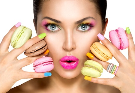 38453157 - beauty fashion model girl taking colorful macaroons